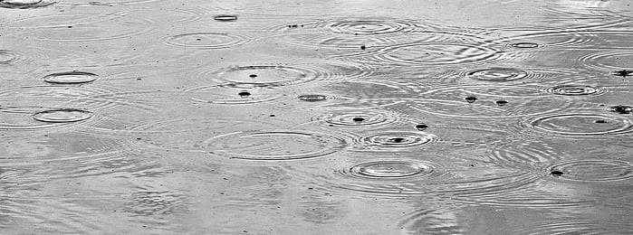 Raindrops On Water Surface